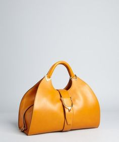 Gucci:  pumpkin leather 'Stirrup' top handle bag