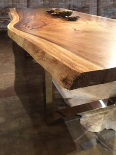 Made from solid parota wood 24e DESIGN CO custom live edge dining tables are all made to order one of a kind pieces.