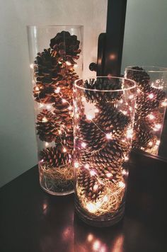 Simple and inexpensive December centerpieces. Made these for my December wedding… Simple and inexpensive December centerpieces. Made these for my December wedding! Pinecones, spanish moss, fairy lights and dollar store vases. Noel Christmas, Christmas 2019, Winter Christmas, Celebrating Christmas, Christmas Decorations Apartment Small Spaces, Christmas Decorations Diy For Teens, Christmas Decorating Ideas, Christmas Lights In Jars, Christmas Pine Cone Crafts