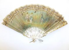 19th Century Mother of Pearl Fan with hand painted silk mount, decorated with gilt metal and cut steel sequins, with a gold gauze reverse, on carved and pierced sticks and guards with painted floral decoration, 22cm (boxed)