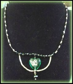 Black & green poodle necklace by Purrwoof on Etsy, $12.00