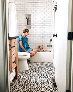 Moroccan tiles, very low bath and shower over - small bathroom