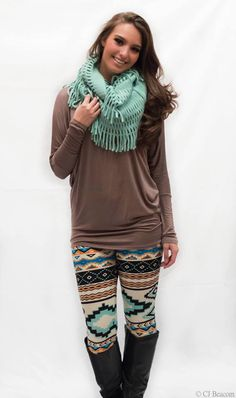 Dolman Top paired with Printed Leggings and a scarf! LOVE THIS LOOK!   brown tealaztec abstract black boot comfortable fall 2014 fashion spring 2015 outfit idea popular trending model bad habit boutique long brown hair curly fashion style blog