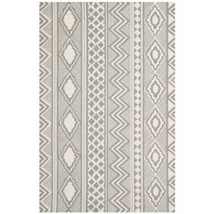 Richly textured, the grey and ivory Santa Fe Trails rug from Isaac Mizrahi New York Collection Rugs evokes the trend to global tribal motifs in clothing and home decor.