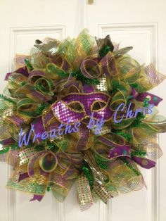 """http://www.facebook.com/WreathsByChris A wreath fit for Carnivale! Celebrate Mardi Gras with this gorgeous wreath. 10"""" Mesh purchased from http://www.trendytree.com"""
