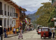 Jardin, Colombia. Each morning locals occupy the main square to sip a cup of rich, Colombian coffee, seated on colourful chairs that are painted in vibrant hues to match the exuberant facades of the town's colonial houses.