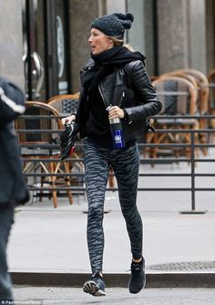 Fashionable jaunt: She was seen crossing the street in a dark workout outfit