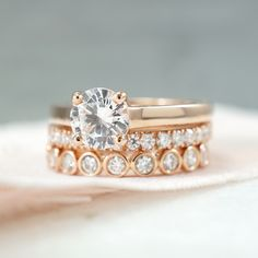 Rose gold is ALWAYS a good idea! 🌹 This stack features a solitaire engagement ring with a round brilliant diamond, a split prong set diamond wedding band, and a bezel set diamond wedding band.  JosephJewelry.com | Designed and created by Joseph Jewelry | Seattle, WA | Bellevue, WA | Online | Design Your Own Unique Engagement Ring | #engagementring Wedding Sets, Wedding Bands, Joseph, Black Diamond Bands, Wedding Rings Rose Gold, Halo Diamond Engagement Ring, Instagram, Unique, Seattle