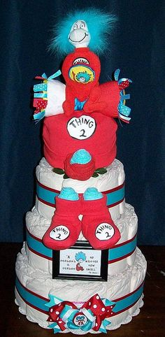 Thing 1 and Thing 2 Baby Shower Diaper Cake.  if mom has a sense of humor... really cute for twins =)