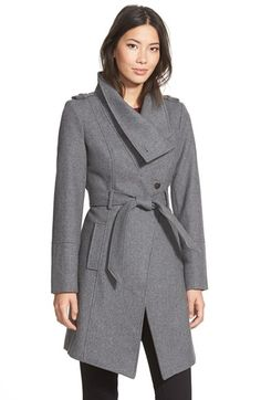 GUESS Belted Asymmetrical Wool Blend Trench Coat at Nordstrom.com. Sporty fencer styling informs the polished look of a heavy wool-blend coat that buttons up to a funnel neckline and dips to a cutaway front. Epaulets, gleaming hardware and a printed lining add refinement while a tunneled belt nips the silhouette.