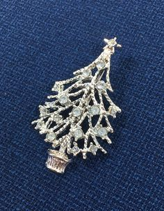 See new listings daily - follow us for updates.  Christmas in July Sale Silver and Blue Christmas #Tree Brooch, Baby Blue Tree Pin, Blue Christmas Brooch, #Silver Christmas Tree Brooch, Silver Tree, #Holiday Pin, Christmas, ... #vintage #jewelry #teamlove #etsyretwt #bestofetsy #tree #mimisjewelryboutique #holiday #silver #rhinestones ➡️ http://jto.li/w8r8K
