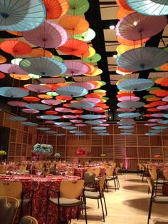 Amazing array of our Paper Parasols hung upside down (http://www.paperlanternstore.com/paper-parasols.html)