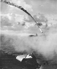 Japanese plane shot down during the Battle of Saipan, near Saipan; circa June 15 – July 9, 1944.
