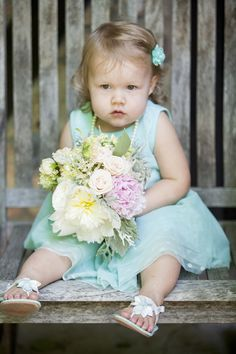 How cute is this baby with the bouquet? Photo by Sara C. #MinneapolisWeddingPhotographer #KidsinWeddings #Love #Adorable
