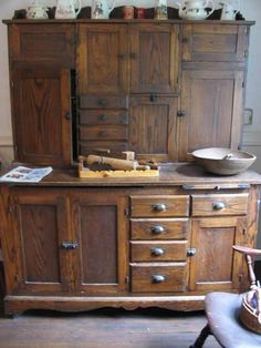 I really, really like these Hoosier cabinets. I would love to have one in my new kitchen and I will have room in front of my pantry wall.