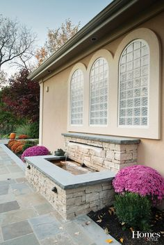 """""""The south side gets all the sun and the owners wanted to have a little niche and a small fountain to enjoy the sunshine, as well as provide a quite escape. So we created a wonderful sitting area that makes use of a fountain that creates additional seating as well as adds visual interest to the home."""" Project Design & Installation by Maverick Landscaping http://www.mavericklandscaping.com/ with Kelly Van Elders http://www.vanelders.com/ Photo by Matt Kocourek http://www.mattkocourek.com/"""