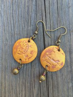 orange gold clay imprinted circles with garnet. by hippsieloveshop. #hippsieloveshop #etsy
