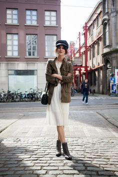 Outfit: military jacket, white lace dress and fiddler cap