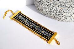https://www.alittlemarket.com/bracelet/fr_bracelet_manchette_bracelet_large_bracelet_ethnique_motifs_serpent_bracelet_boheme_or_gris_noir_tissage_de_perles_bijoux_femmes_-17320120.html