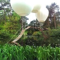 "Pont de Singe, Tatton Park, Knutsford, Cheshire, U.K. Yep, it's a bridge suspended in the air by three helium balloons! Off limits to pedestrians when it was unveiled during an exhibition at Tatton Park Biennial in 2012, Pont de Singe (which translates to ""Monkey's Bridge"") allegedly can hold only one human at a time. But how many monkeys? Hmmm...."