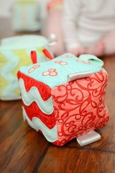infant taggie blocks ! Something to work on while you are waiting for baby to come home. Consider using the preemie clothes your baby outgrew as the fabric!
