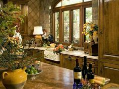 Tuscan kitchen, variety of textures: wood, stone, flowers etc