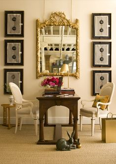 Bunny Williams. Unexpected formal mirror exposes loft ceiling and walls + art treatment display in eclectic versatile office space.