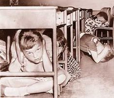 Because if they drop a nuclear bomb, hiding under that small wooden desk is totally going to make all the difference.