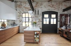 Love the distressed exposed brick