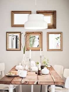 Tiny Stylish Apartment In Sweden- thlis would make a great look in a small dining area in a mobile home. framed mirrors rustic table modern chairs and lighting- I like it...