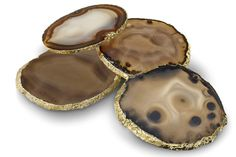 Set of 4 These exquisite pieces, edged in 24K gold and silver, take coasters to a new level. Distinctive and unique designs, they are perfect as gifts for your favorite hosts. This is a natural produc