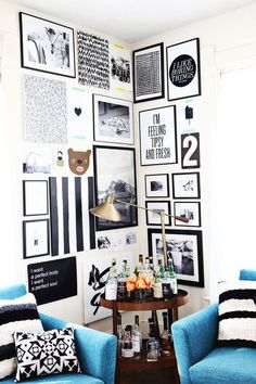 A contemporary black and white corner gallery with pops of blue. Awesome look for a college apartment or dorm! | thewildflowergirl.tumblr.com