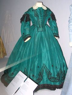 I like the teal of this dress, and the design on the skirt is cool.