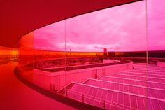 your rainbow panorama.    This piece, known as Your rainbow panorama (2006-2011) can be found on top of the ARoS Aarhus Kunstmuseum, Denmark.  Eliasson was chosen by a five panel judge to build this 150 foot long, 3 foot wide circular corridor, which features glass made of all the colors of the rainbow.  The piece is elevated 3.5 meters above the museum's roof and cost 60 million Danish kroner to build,  or 10,431,180.00 US dollars by today's exchange rate.