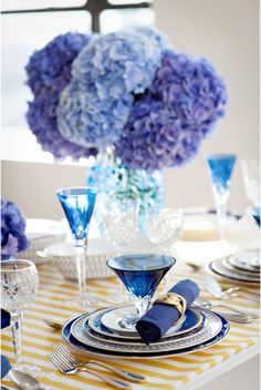 Interesting combination of yellow and white stripes with blue and turquoise table settings.