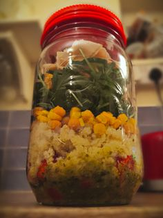 My first mason jar salad! So tasty! Basil pesto with oil, couscous, chickpeas, sweet corn, rocket, croutons, cucumber, chicken (French dressing container at the top).