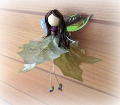 Check out this item in my Etsy shop https://www.etsy.com/listing/256796272/flower-fairy-faerie-ornament-angel