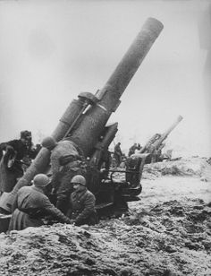 The crews of two Soviet Br-5 heavy mortars (280-mm) prepare to open fire somewhere on the Eastern Front. This was the heaviest Soviet field piece. The Br-5 was one of the most crucial weapons during the Battle of Berlin. Its 168-kg HE shell would create 10-meter wide craters upon impact, with a zone of devastation out to 100 m.The weapon had low rate of fire due to barrel overheating.