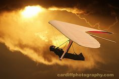hang gliding!!....yes with the awesome sun set in the background....or over Jesus in Rio de Janiero
