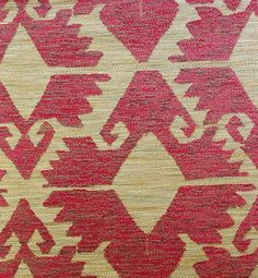 Kilim Woven Upholstery Fabric Heavy weight upholstery fabric in the style of a turkish rug, in raspberry red and pale gold