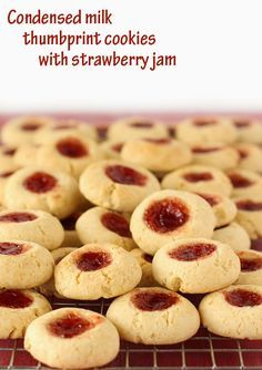 Condensed milk thumbprint cookies (1/2 stick or 1/4 cup) unsalted butter, room temperature 100g (1/2 cup) granulated (white) sugar 200g (2/3 cup) sweetened condensed milk 1 large egg 350g (2 4/5 cups) all-purpose (plain) flour 1 1/2 tsp baking (bicarb) soda 1/2 tsp salt 1/3 cup strawberry (or other) jam