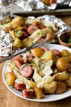 An easy dinner on the grill! Cabbage and sausage foil packets are the perfect effortless easy meal! Tender potatoes, smoky sausage, onion and sweet cabbage seasoned with garlic butter and all cooked in a tidy little packet on the grill!