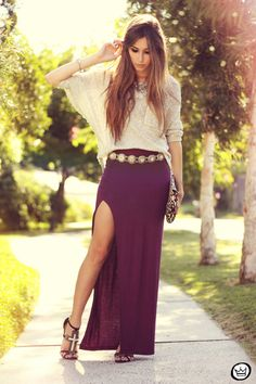 How to wear a maxi skirt: Pair with a unique, statement belt that sits loosely around your waist