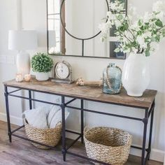 Pieces of reclaimed wood form a richly grained mosaic on this console table. Entrance Decor, Entryway Decor, Hallway Table Decor, Pottery Barn Entryway, Entrance Hall, Entryway Console Table, Decorate Console Tables, Console Table Styling, Entry Tables