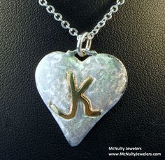 Sterling silver and 14kt yellow gold custom monogram heart pendant to celebrate a special occasion.  McNulty Jewelers original design