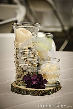 Rustic Centerpiece PERFECT for our GEOLOGY themed wedding!! Maybe one filled with rocks with a candle ontop and the other two with flowers (purple/green)