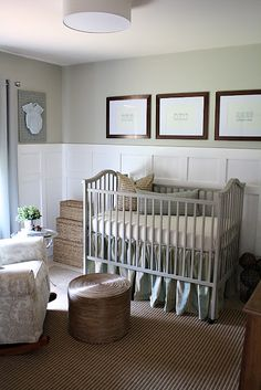 Calming color combos for baby's room: Valspar Cliveden Gray Morning on walls. Lovely sayings in dark frames over painted crib, textured rug. From Twenty Three Oh One.