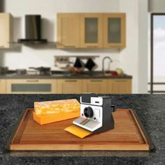 Say cheese! You can't take pictures with the Polaroid Cheese Slicer (obviously! Read more Polaroid Cheese Slicer Gives You Instant Cheese Slices Best White Elephant Gifts, Polaroid Instant Camera, Bathroom Decals, Moose Mug, Photo Vintage, Beer Opener, Love Pizza, Butcher Block Cutting Board, Spice Things Up