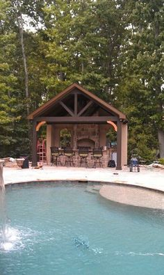 outdoor kitchen at the other end of the pool not on the house - Backyard Designs With Pool And Outdoor Kitchen