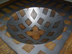 CNC wood, pour metal/plastic into spaces, CNC again http://cncprinter.blogspot.com/2011/03/eichenschale.html
